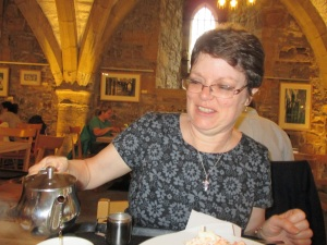 Linda pouring tea in Durham Cathedral