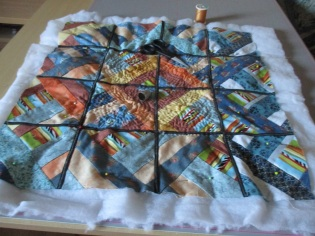 Annete's table topper half quilted